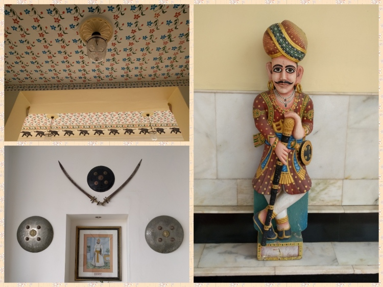 Marble figurine of a courtier, coat of arms of the Maharaja and an ornate ceiling