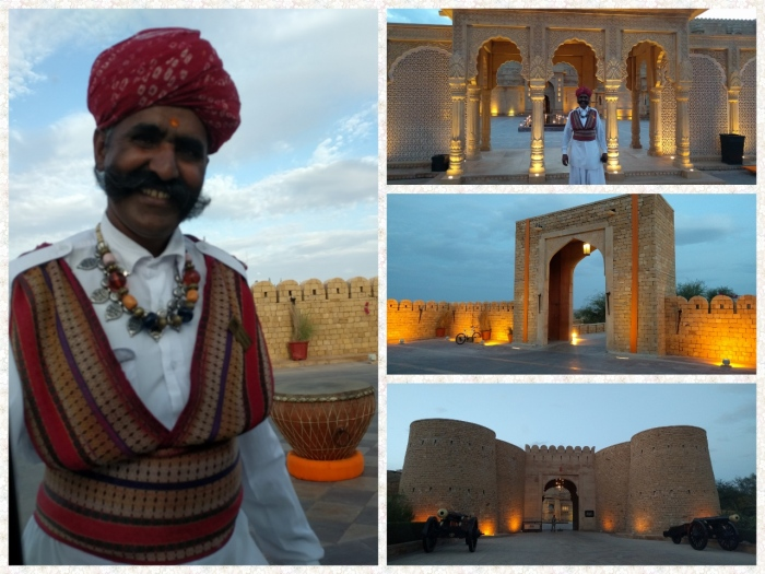 The Suryagarh Palace Doorman, entrance to the resort, resort walls lit during twilight