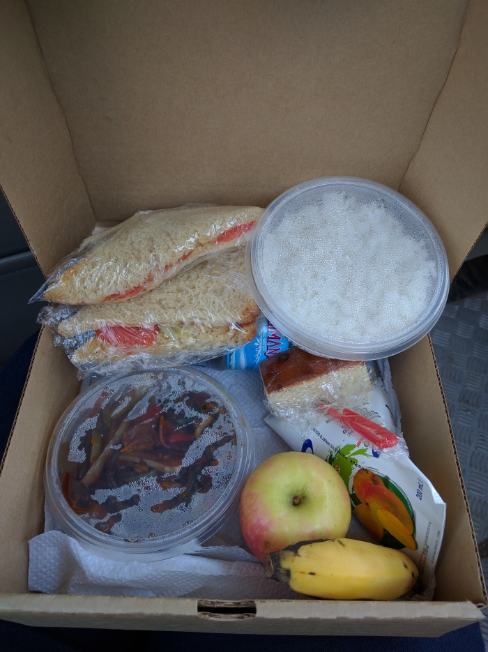 Sandwich, Rice and stir fried veggies, fruit and a drink