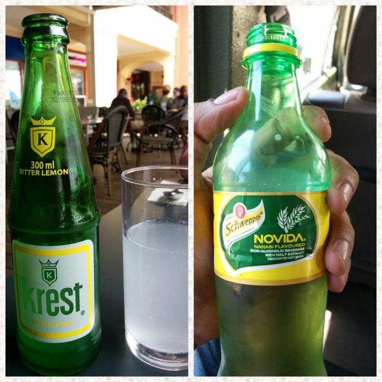 A bottle of Krest Bitter lemon and a bottle of Schweppes pineapple drink