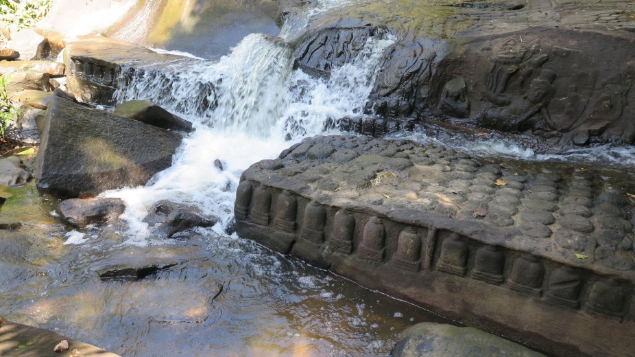 Hundreds of lingas sculpted on rocks lying on the river bed of Kbal Spean