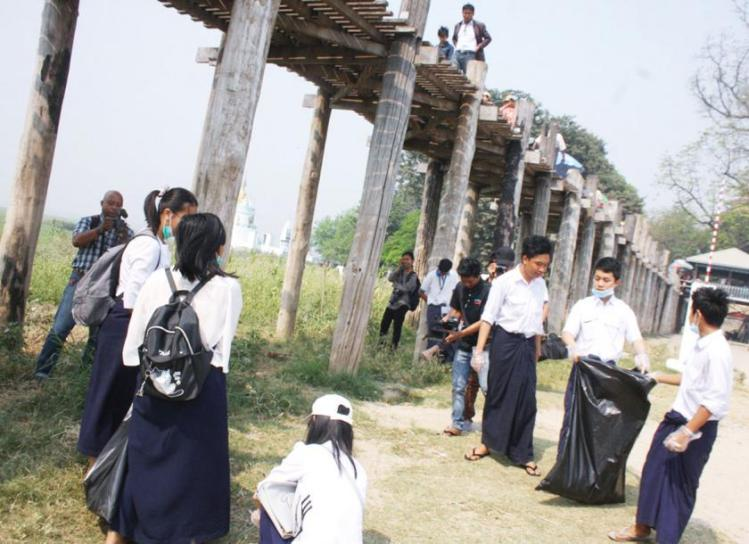 Students lead the way towards bringing in a culture of cleanliess. Here they are seen participating and leading a cleanliness drive along the banks of the U-Bein bridge.