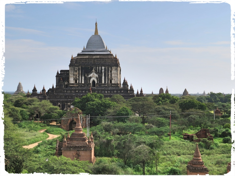 "Thatbyinnyu is Bagan's tallest temple at almost 200 ft. (or 61 m.; some indicate 217 ft. or 66 m.) and represents a transition from the Mon period to a new architectural style that would soon be followed at the Sulamani, the Gawdawpalin and at Htilominlo. Constructed during one of the high points of Bagan political power and during a period of re-dedication to Theravada Buddhism and religious scholarship, it reflected that era's innovative architectural and artistic creativity. Paul Strachan, the important Bagan scholar, calls Thatbyinnyu ""an expression of the self-confident Burmese spirit of nationhood."" (Courtesy : www.orientalarchitecture.com)"