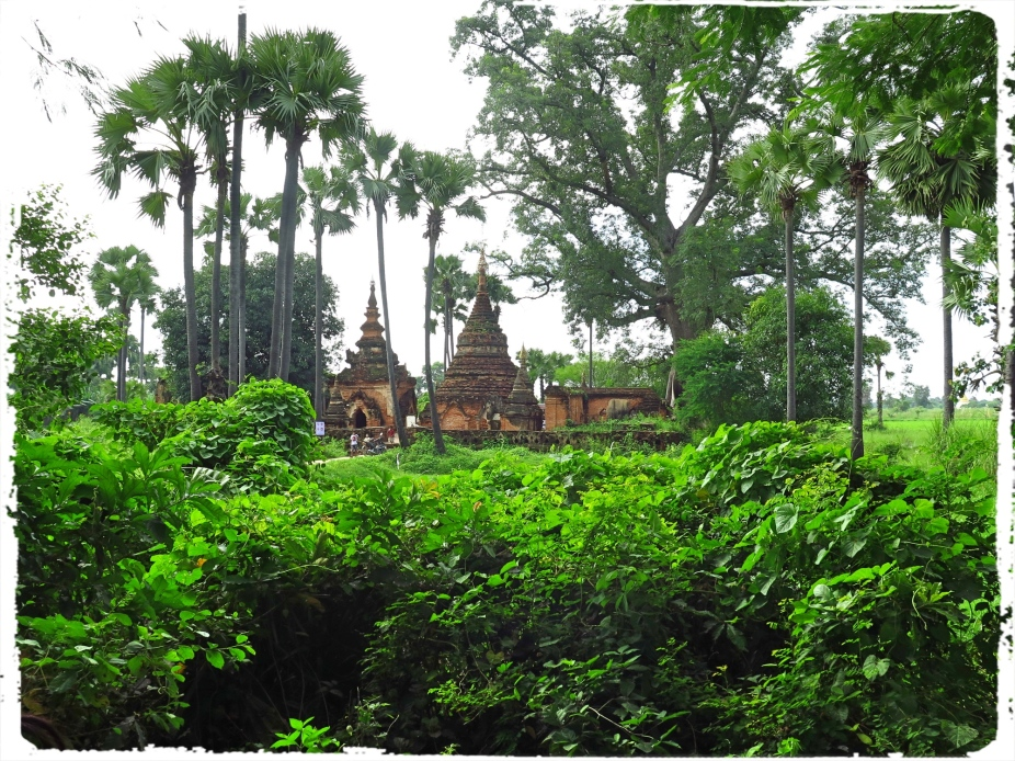 The Yedanasini temple is probably among all the well photographed temples in Myanmar. Set amidst thick countryside vegetation, the brick monument stands out in contrast in terms of color values.