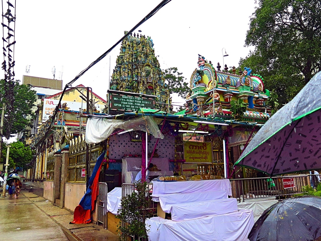 The Gopuram of Kali temple towers above the smaller gopuram near the entrance
