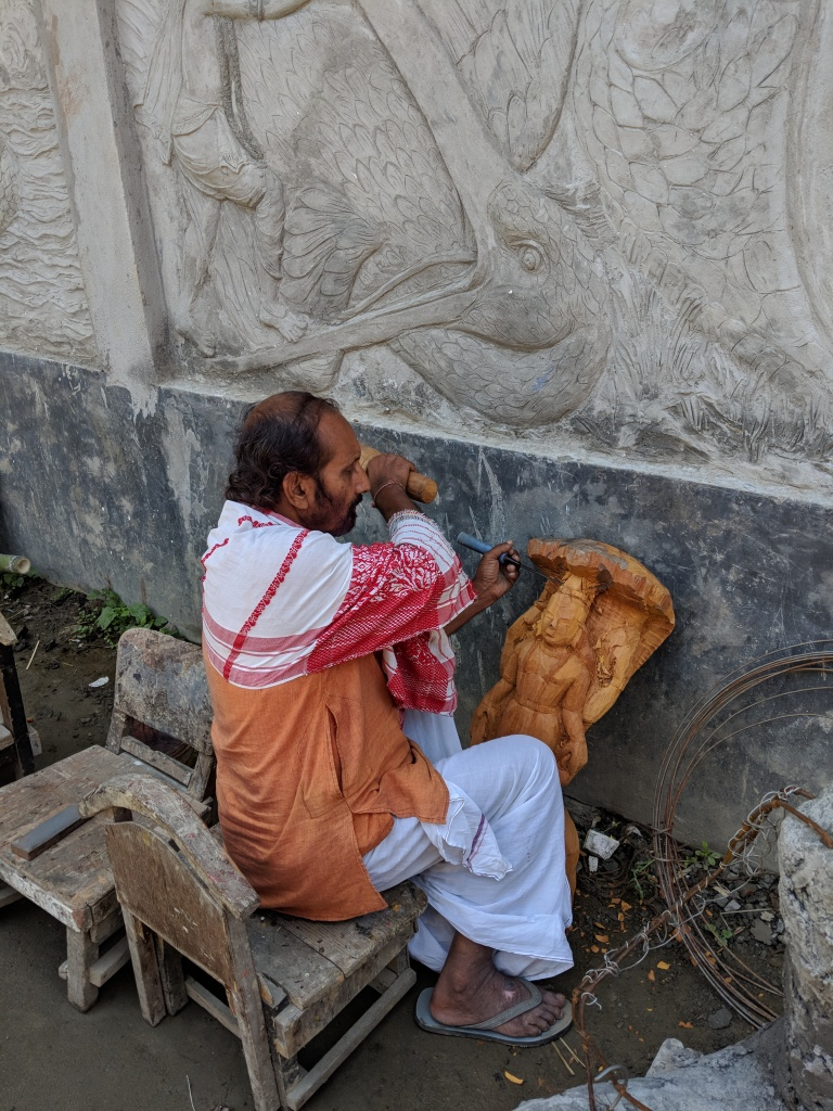 Guru Hemchandra Goswami at work on a wooden scultpture