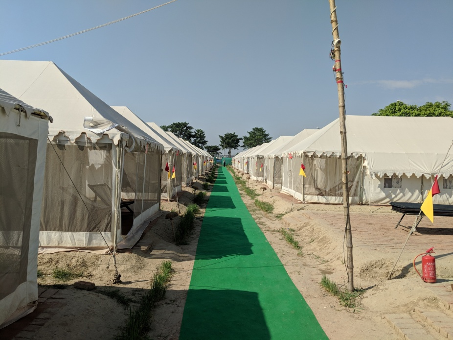 The Tent city with a green carpet, tents and fire fighting equipment