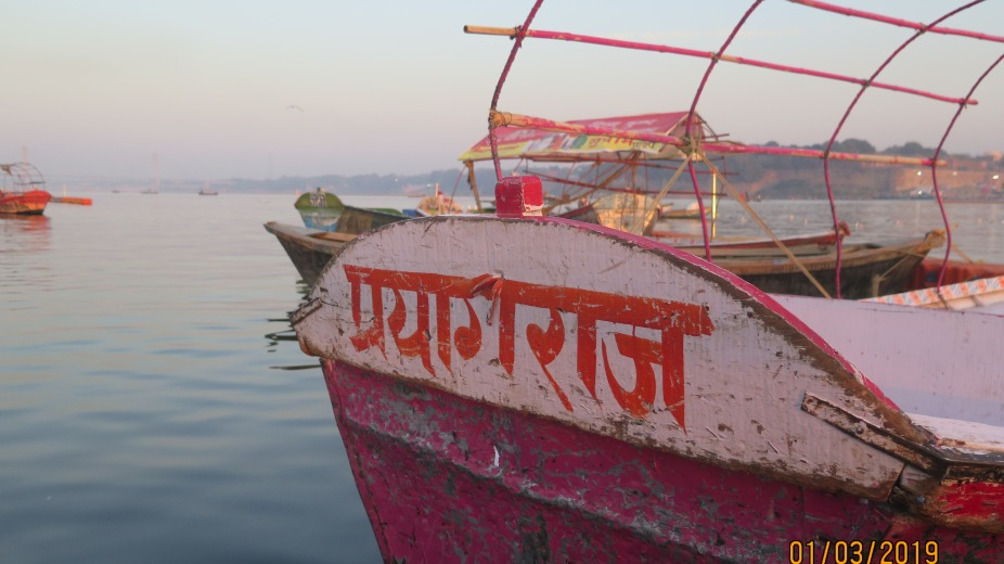 One of the boats on the banks of the Ganges ready to transport devotees to the Triveni Sangam
