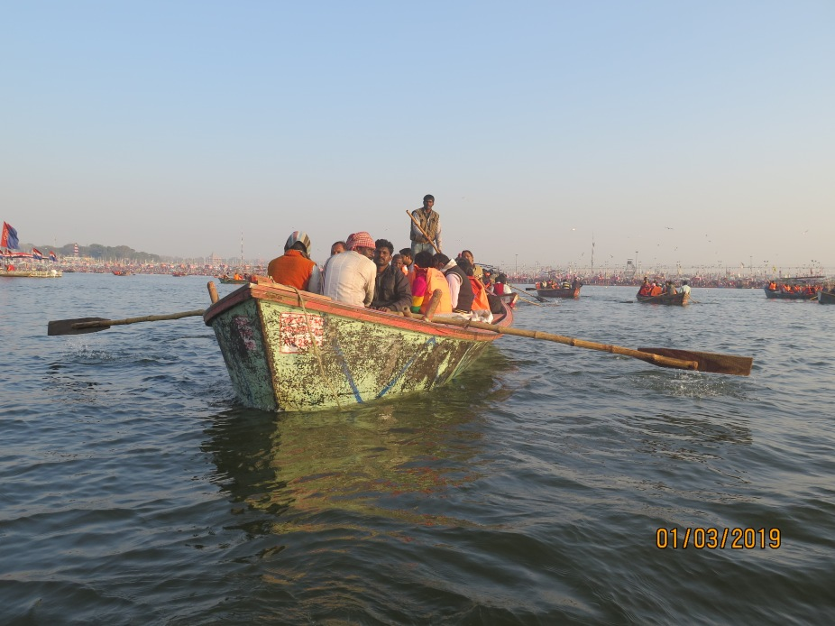 Passenger traffic on the Ganges transporting devotees and workers headed towards the Ghats.