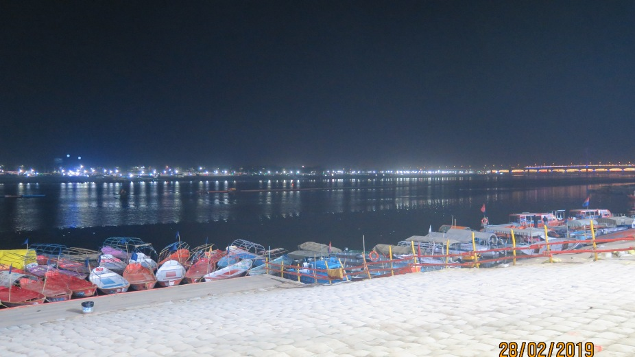 River Ganges, boats docked and the well lit bridge