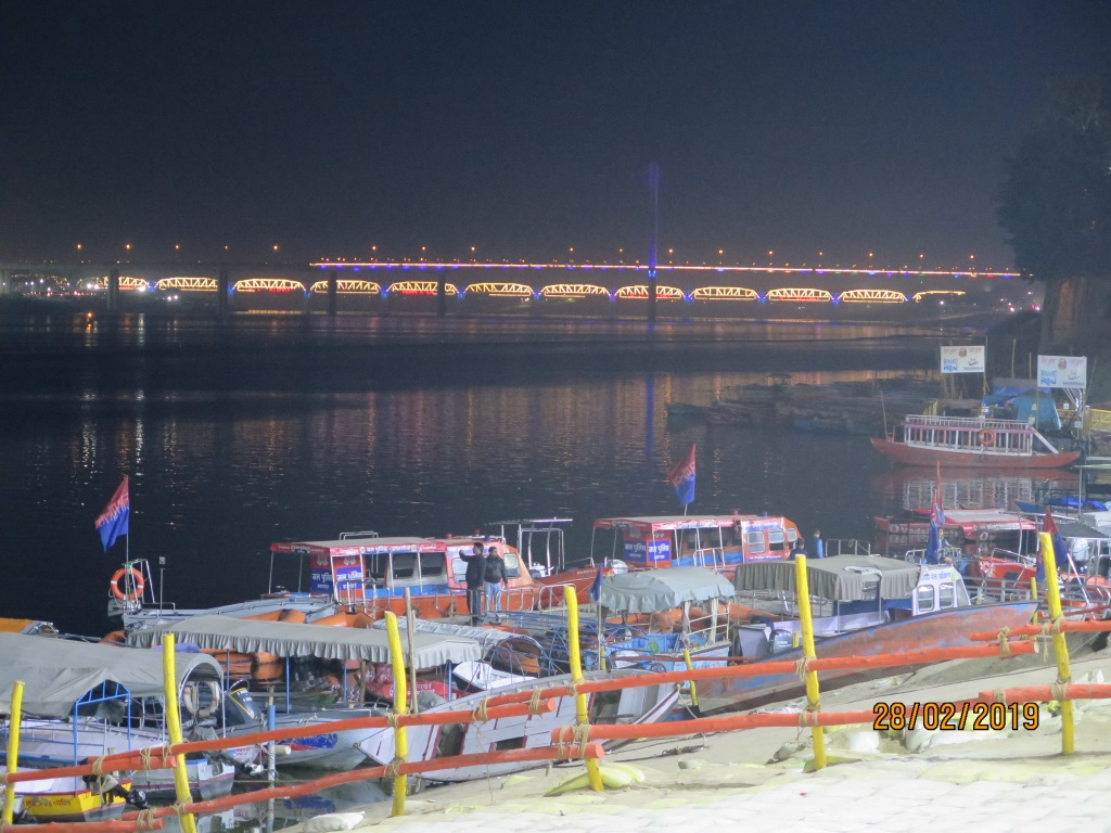 The well lit bridge viewed from the banks of the Ganges at Prayagraj