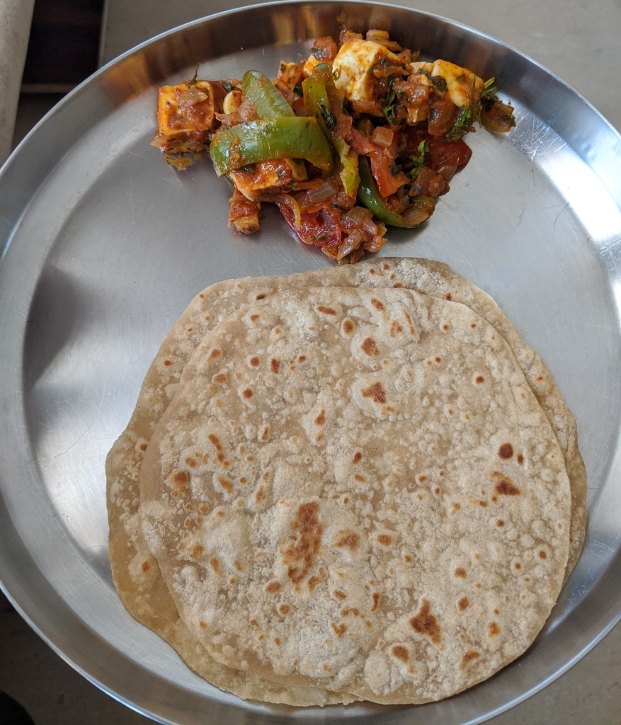 Kadai Paneer with 2 chapatis in a plate