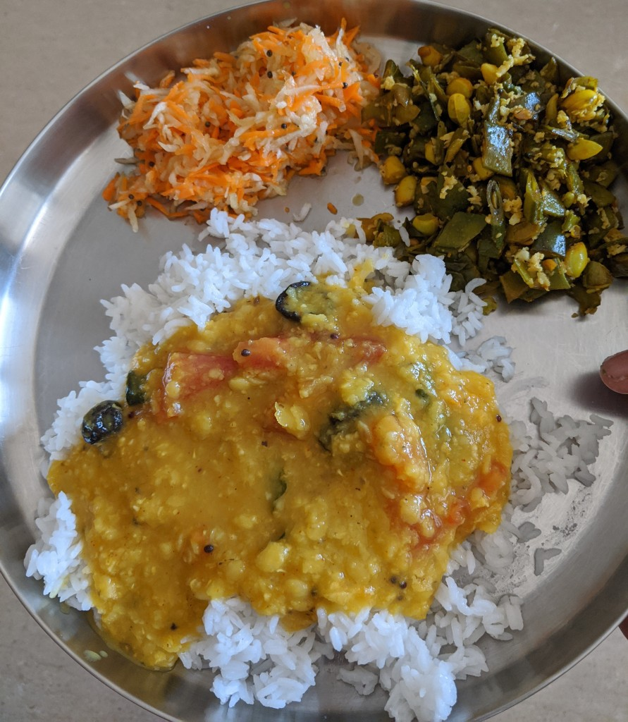 Rice with Amti, Broad beans curry and a grated salad