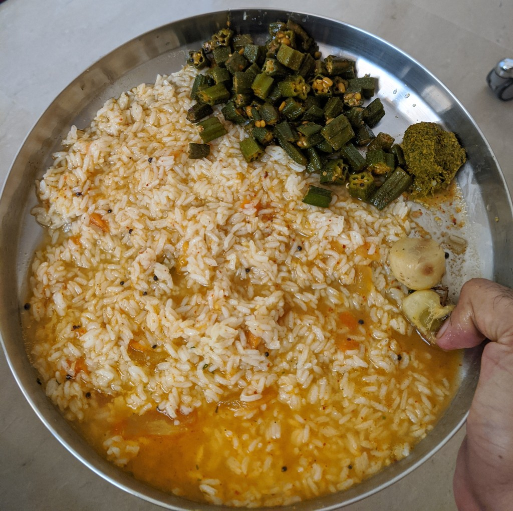 Poricha Rasam and rice, Bhindi subzi, Kothamalli (coriander) thuvayal along with steamed amla