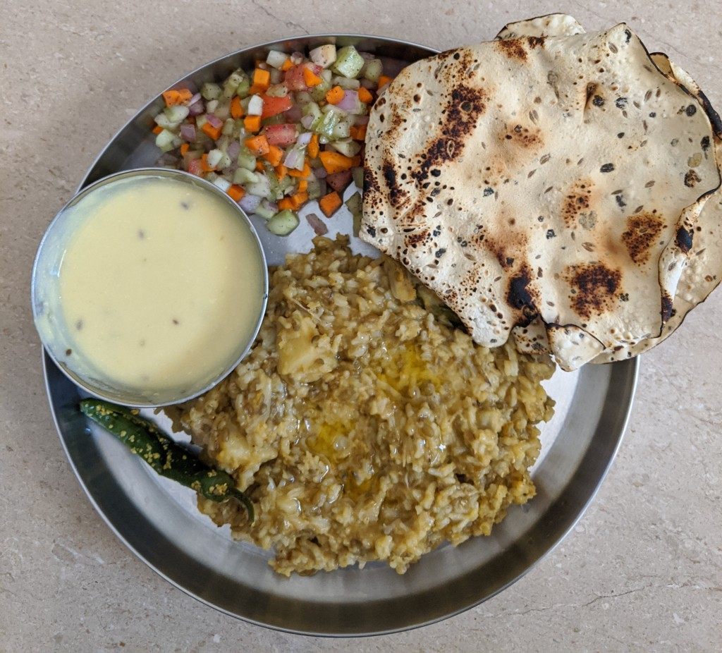 Vegetable khichdi, Gujarati kadi, athanu marcha, some salad and of course a Gujarati papad