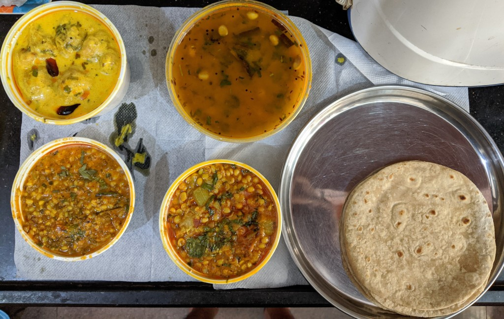 Dahiwala moong sabzi, Dudhi (bottlegourd) with chana subzi, Pakodi kadi and Gujarati dal with Rotis