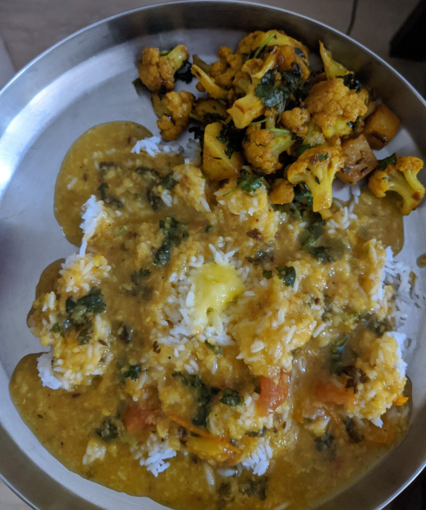 Dal rice and ghee with Cauliflower and potato subzi