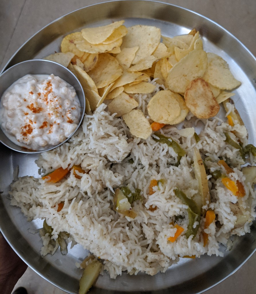 Vegetable pulav with boondi raita and potato chips